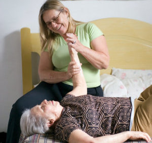 caregiver and patient in a physical therapy session