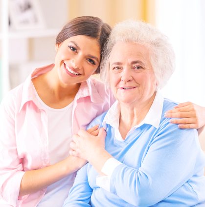 caregiver and senior woman smiling